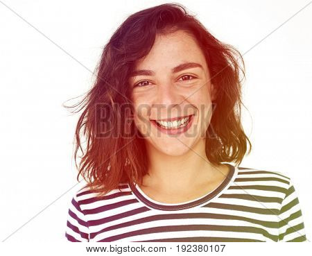 A woman with striped shirt is smiling