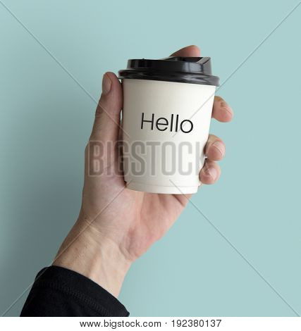 Hand holding network graphic overlay coffee cup