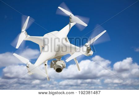 Unmanned Aircraft System (UAV) Quadcopter Drone In The Air.