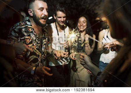Group of friends party celebration firework