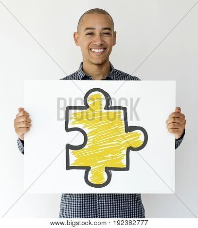 Man hands hold show blank paper with puzzle symbol