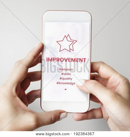Hands holding smart phone with star development icon