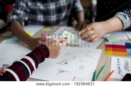 Group of people brainstorming meeting in the room