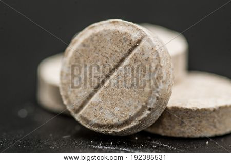 colorful medicine pills on the black background