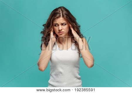 The portrait of disaffected woman on studio background