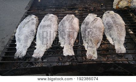 Five Tilapia salt crusted grilled Fish .
