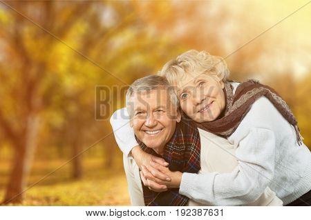 Portrait couple elderly hugging two people senior adult heterosexual couple