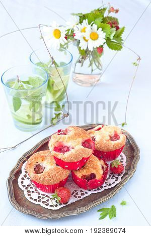 Fresh homemade delicious berry muffins on plate