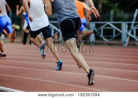 group of runners sprinters men run 200 meters at competition