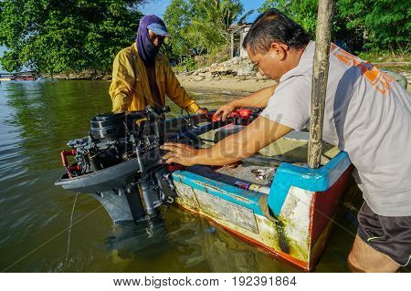 Labuan,Malaysia-June 10,2017:Morning scene of daily activities at Labuan fisherman village,fisherman checking the gas level before start to fishing in Labuan Pearl of Borneo,Malaysia.
