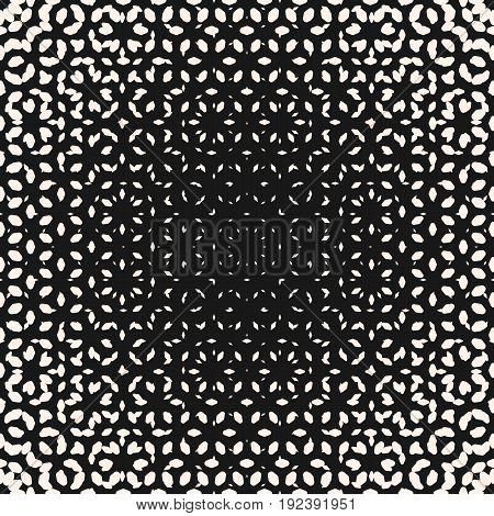 Halftone pattern. Monochrome texture with small rounded shapes, visual effect of gradient transition, circular form. Abstract ornamental background. Modern design for prints, covers, decoration. Seamless pattern.