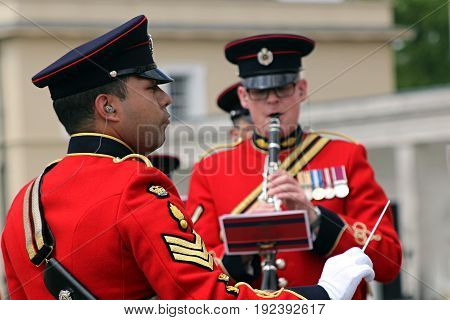 Sandhurst, Uk - June 18 2017: Conductor And Woodwind Player Of The Military Band Of The Corps Of Roy