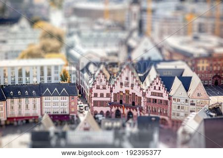 Top view on the old buildings with city hall on the market square in Frankfurt city. Tilt-shift image technic