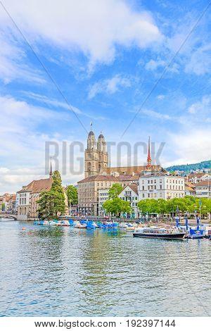 Minster Grossmunster in Zurich view from Quaibrucke bridge river Limmat in front.