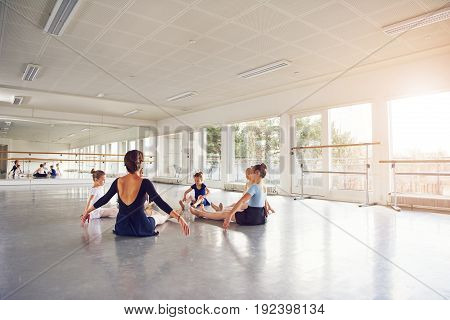 Group Of Young Girls Dancing Ballet Sitting In Circle