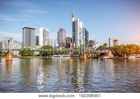 Morning view on the financial district with Main river in Frankfurt city, Germany
