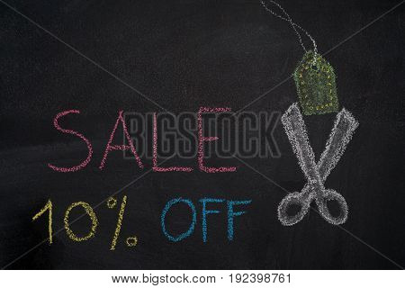Sale 10% off. Sale and discount price sign with scissors cutting price tag drawn with chalk on blackboard
