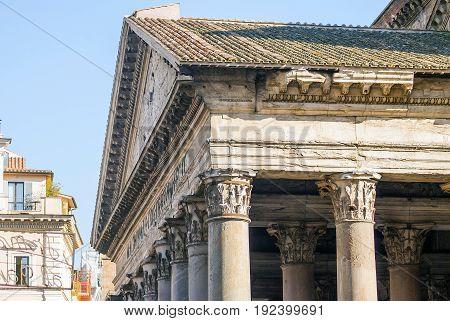 close up of the Pantheon pediment with latin inscription, corinthian capital columns, Rome, Italy