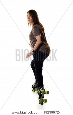 woman roller skating backwards and stopping on white