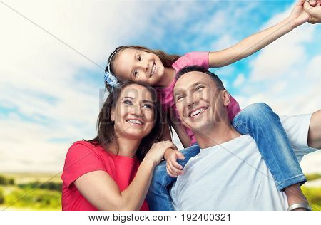 Happy smiling family daughter elementary age pre-adolescent child fun