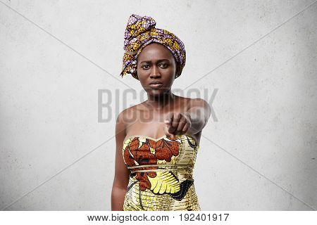 Portrait Of Middle-aged Black Woman With Slender Figure Wearing Scarf On Head And Beautiful Dress St