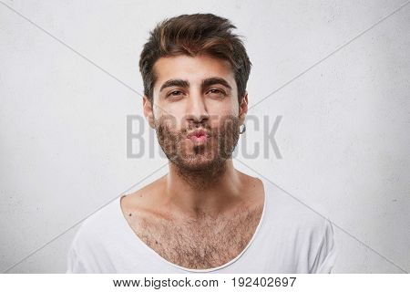Lovely Handsome Guy Flirting With Girl Blowing Her Kiss. Unshaved Man With Attractive Appearance Sho