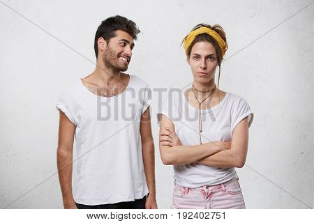 Studio Shot Of Handsome Positive Bearded Male In White T-shirt Trying To Convince Or Apologize To Hi