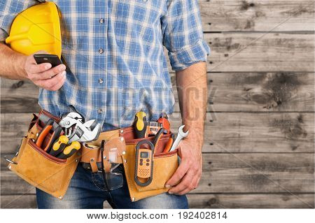 Male worker belt tool belt background isolated business