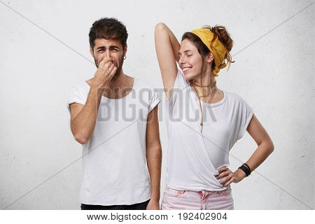 Problems With Body Odor. Disgusted Male Pinching His Nose Feeling Bad Smell Or Stink Coming Out From