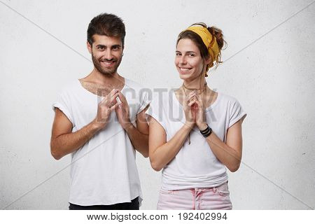 Tricky Crafty Young Couple Smiling Mysteriously, Clasping Hands, Plotting Or Scheming Something, Kee