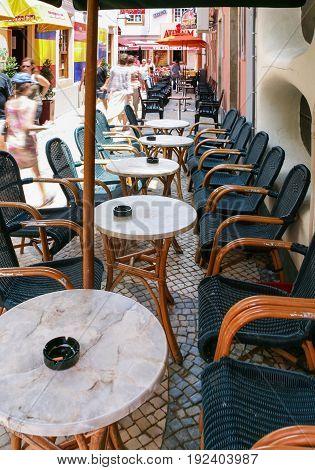 Tourist Near Tables Of Restaurants In Albufeira