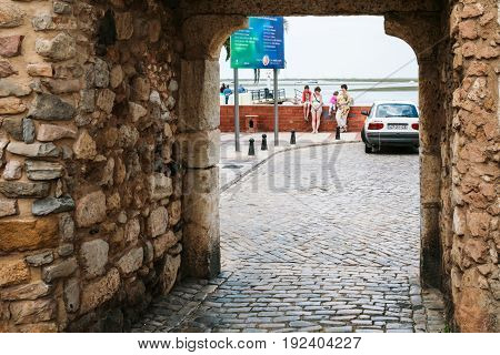 Tourists Near Gateway To Ria Formasa In Faro