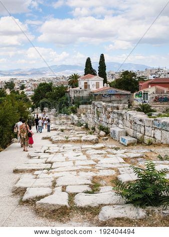Tourists On Road In Ancient Agora Area In Athens