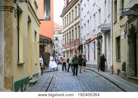 People On Wedding Ceremony In Old Riga Town