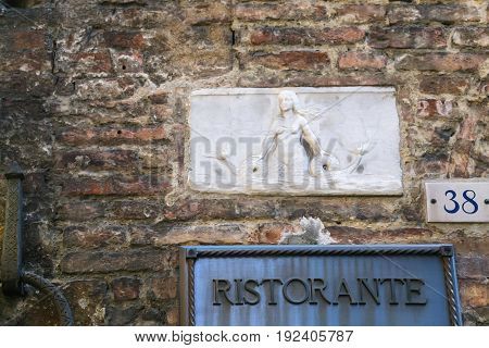 Relief On Wall Of Medieval House In Siena