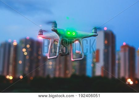 A process of launching the quadcopter drone with camera, operator pilot launches quadcopter uav, unmanned aerial vehicle flying
