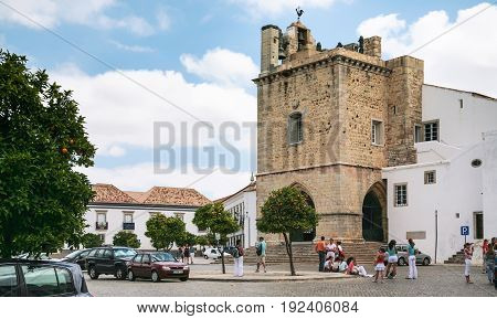 Tourists Near Cathedral Of Faro In Portugal