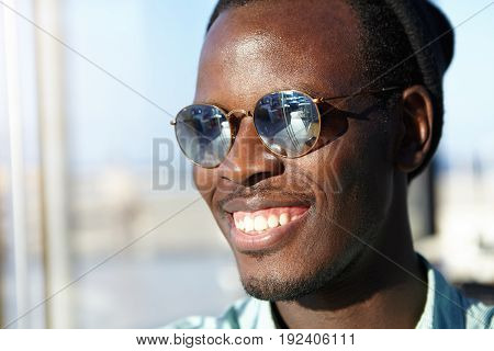 Close Up Of Attractive Male In Sunglasses With Dark Healthy Skin, Bristle Smiling Broadly Showing Hi