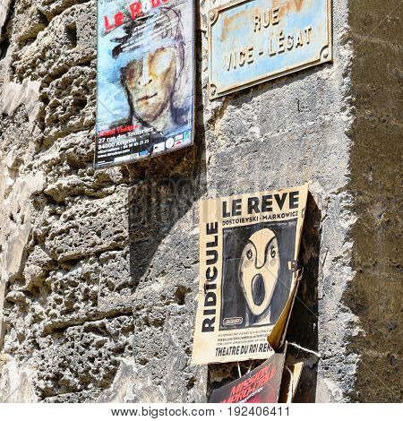Advertising Posters On Medieval Wall In Avignon