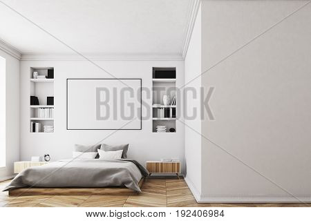 Modern luxury bedroom with white walls a large bed in the center of the room two bookcases by its sides a large window and a framed horizontal poster. 3d rendering mock up