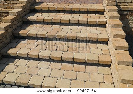 Sett blocks background texture. Tiled colorful decorative stairs.