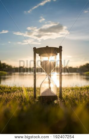 Hourglass under sunlight in the evening (Concept of time)