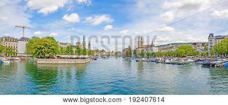Panoramic view of historic Zurich city center with famous Fraumunster Grossmunster and St. Peter and river Limmat at Lake Zurich on a sunny day with clouds in summer Canton of Zurich Switzerland