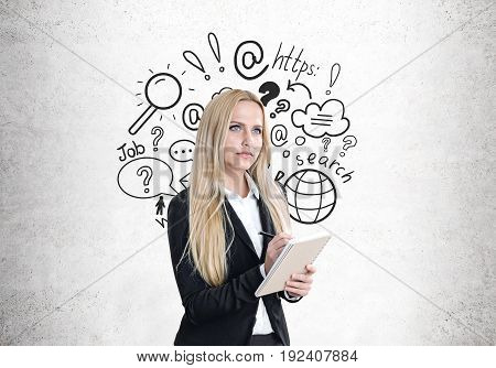 Blond woman with a copybook internet search