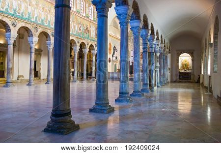 Ravenna Italy - March 1 2012: The aisle of S.Apollinare Nuovo basilica