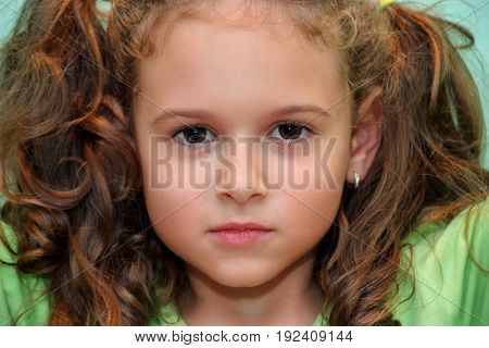 Potrait of cute curly hair little girl