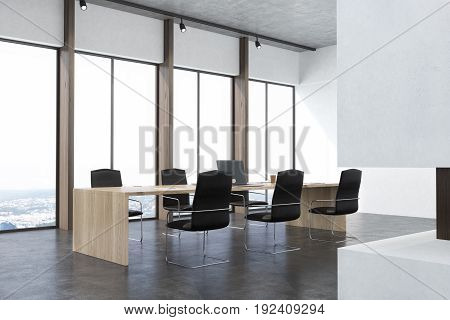 Side view of a conference room interior with white walls concrete floor panoramic windows and a long table with laptops with black office chairs around it. Fireplace. 3d rendering mock up
