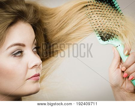 Woman Brushing Her Long Hair With Brush
