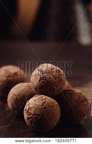 Chocolate Truffles With Cocoa Powder On Wooden Background