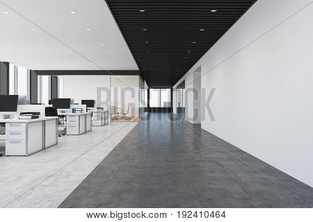 Front view of a loft open space office interior with rows of computer tables with desktops standing on them. 3d rendering mock up